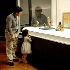 A girl with her father admires one of the dolls on view at the Tokyo National Museum © 2013 Karen Rubin/news-photos-features.com.