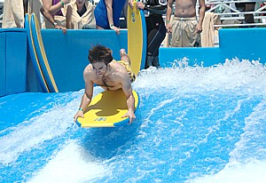 The Flowrider, one of Royal Caribbean Cruise Lines' signature onboard activities. Royal Caribbean is offering families up to 50% savings for third and fourth guests for bookings through May 10 © 2013 Karen Rubin/news-photos-features.com
