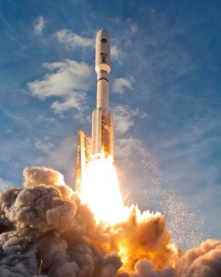 An Atlas V rocket blasts off from Cape Canaveral.