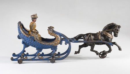 To celebrate the holiday season, the New-York Historical Society is exhibiting nineteenth- and twentieth-century toys from the permanent collection. The display will include a whimsical selection of cast iron, tin, and carved wooden toys and banks made between 1850 and 1945.