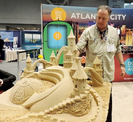 Matt Long gives a demonstration on competitive sand sculpting at Atlantic City, New Jersey's booth at the recent New York Times Travel Show. The DO AC Sand Sculpting World Cup is on now through July 6 © 2014 Karen Rubin/news-photos-features.com
