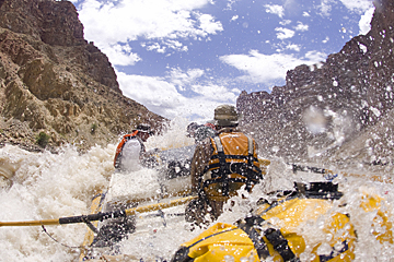 Whitewater rafting in Cataract Canyon in Canyonlands National Park, Utah. O.A.R.S. adventure travel company is operating rafting trips into October.