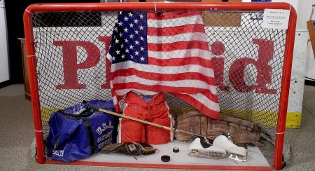 "Hockey goal, Jim Craig's goalie stick and equipment from the 1980 Olympic gold-winning 'Miracle on Ice' equipment on display at Lake Placid's Olympic Museum. Members of the ""Miracle"" team are marking the 35th anniversary by returning to Lake Placid to host a ""Miracle on Ice"" Fantasy Camp © 2014 Karen Rubin/news-photos-features.com"