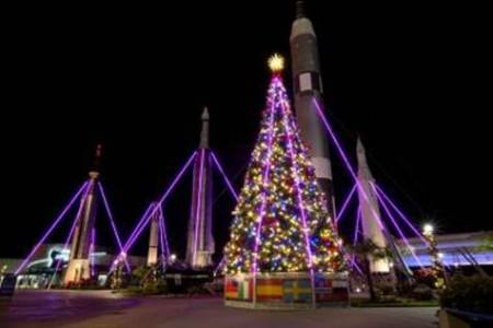 """Kennedy Space Center Visitor Complex is treating guests to an out-of-this-world holiday experience with an all new Holiday Rocket Garden Light Show, part of the attraction's annual """"Holidays in Space"""" celebration."""