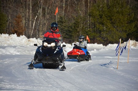 Among the distinctive activities that make Okemo such a marvelous family mountain destination are new kids snowmobile tours on specially designed 'kidsbiles'.