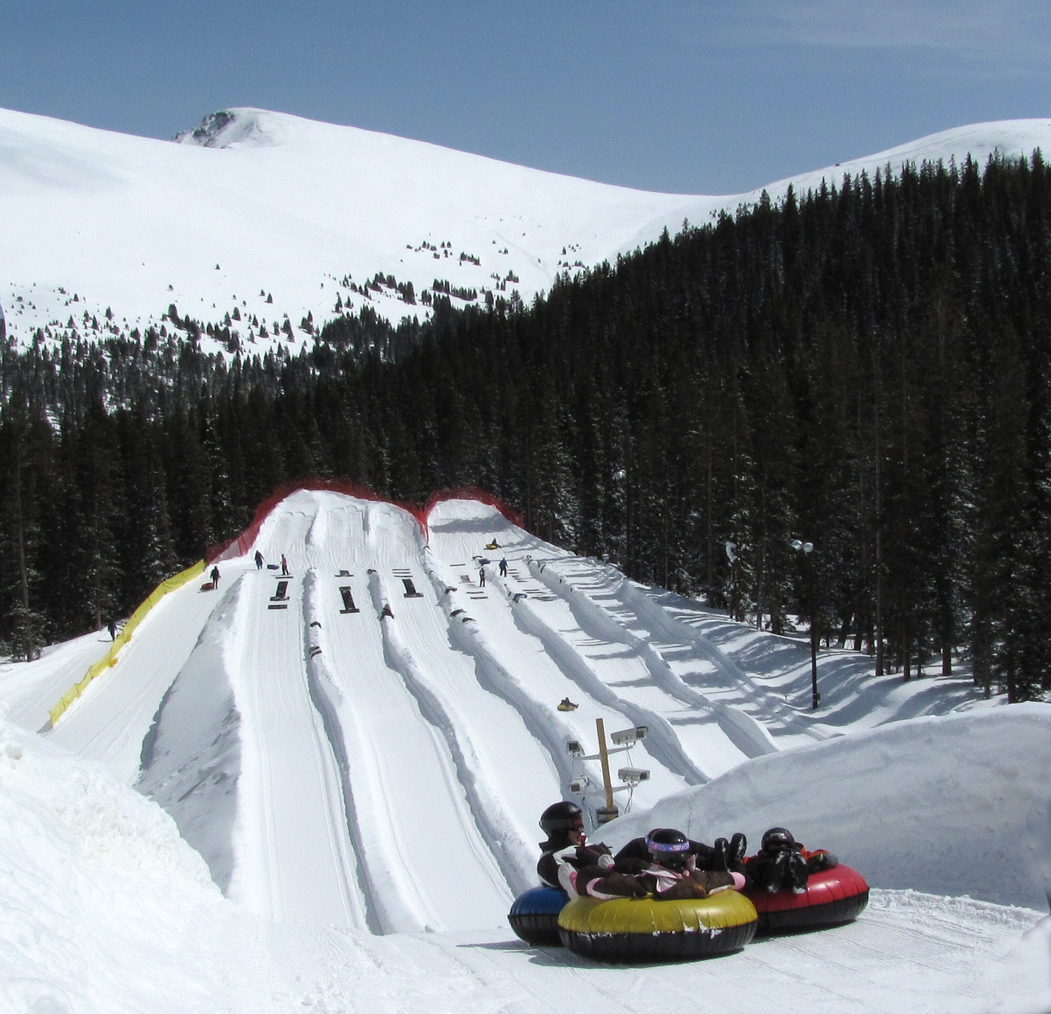 Tubing at the adventure center at family friendly keystone resort in the colorado rockies snow