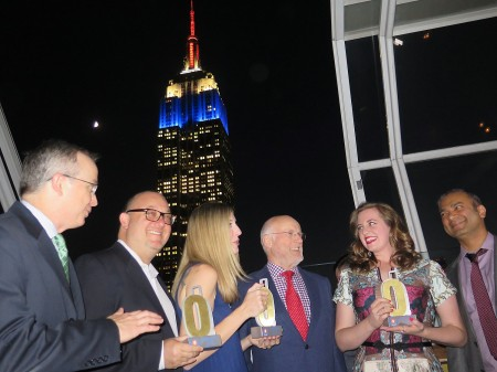 With New York's Empire State Building in the background, Chris Cuddy, Fareportal Chief Commercial Officer (left), Werner Kunz, Fareportal Chief Operating Officer (center), and Sam Jain, Founder and CEO of CheapOair (right) present the Owards to representatives from Savannah, New Orleans and Pensacola at the Inaugural Owards Ceremony at The Strand in NYC © 2015 Karen Rubin/news-photos-features.com