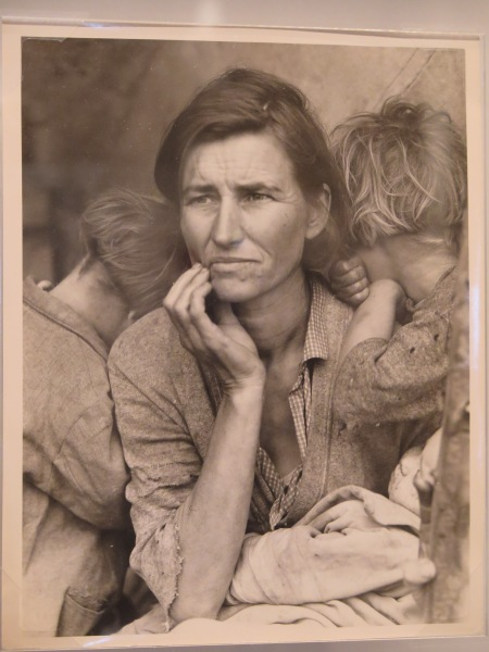 "Dorothea Lange's iconic photo, Migrant Mother, Nipomo, California, 1936,  from the collection of the Kalamazoo Institute of Arts ( Gift of the Photo Guild) will be featured in NCMA's ""Light Works: 100 Years of Photos"", here captured when one of the original 8x10s was exhibited at New York Public Library (Karen Rubin, goingplacesnearandfar.com)."